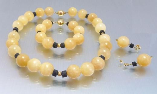 Unikatkette, Armband und Ohrringe aus Orangencalcit und Lava - verkauft
